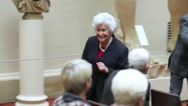 Irina Antonova walks through hall