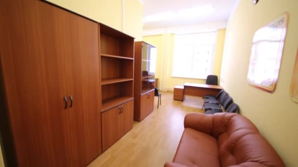 Empty room with sofa, bookcases