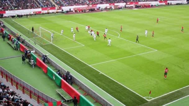 Teams play at football field at stadium