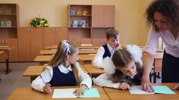Two girls and boy write
