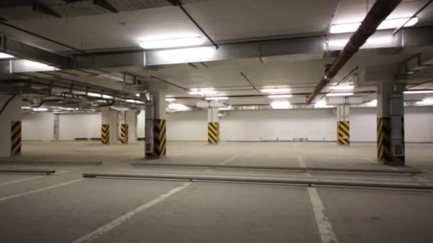 Underground parking with empty parking spaces