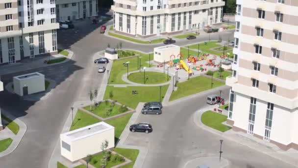 Top view of playground near residential buildings
