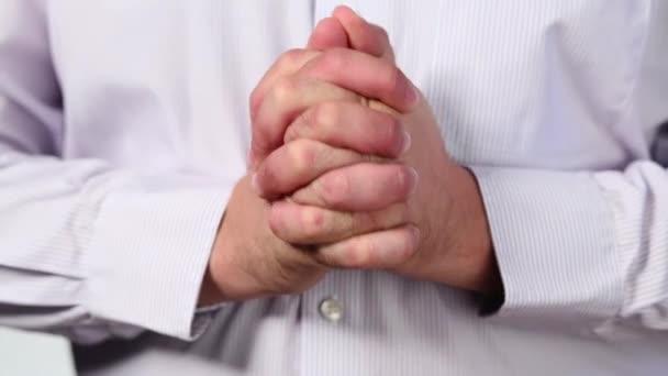 male hands flexing fingers