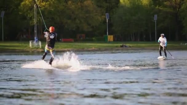 Wakeboarders train on boards at Putyaevsky pond