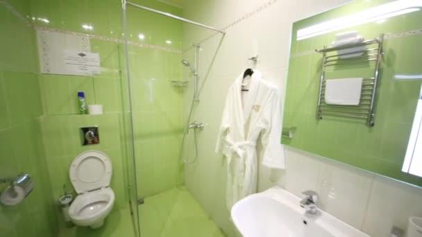 Bathroom with bathrobe on hanger