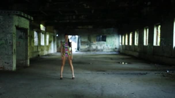 Go-go dancer in abandoned building