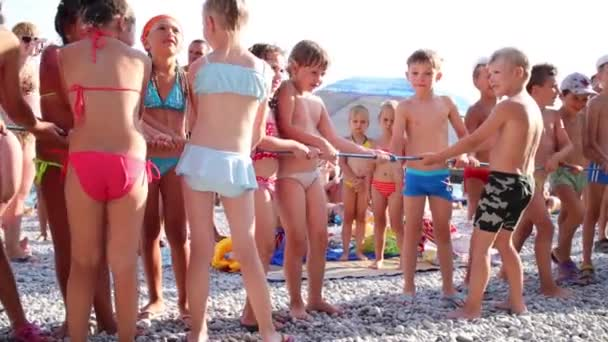 Competition in tug of war between children