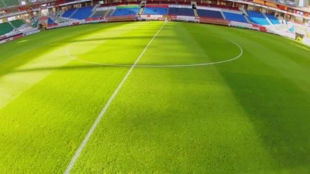Grass field and empty tribunes