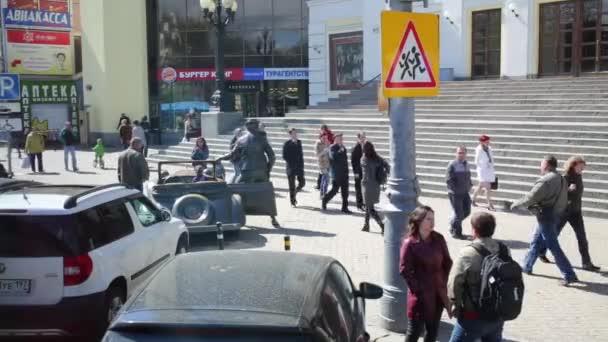 People walk near monument to Yuri Nikulin