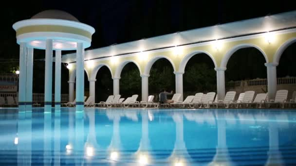 empty swimming pool at summer night