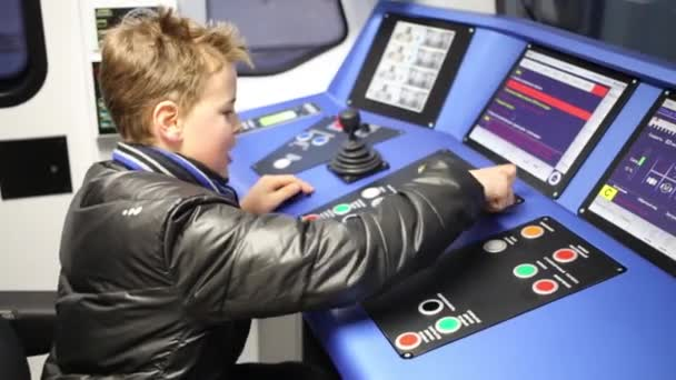 Happy boy with control panel of subway