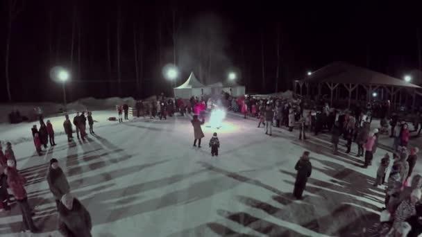 People watch cross in fire