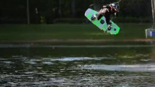 Male wakeboarder jumps on board