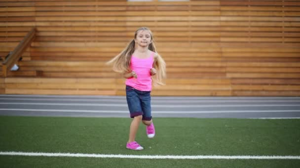 Little girl in pink runs