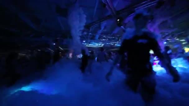 People dancing on foam party