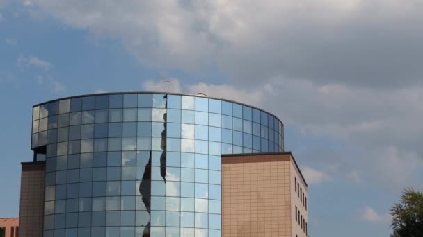 Top of round building with glass wall