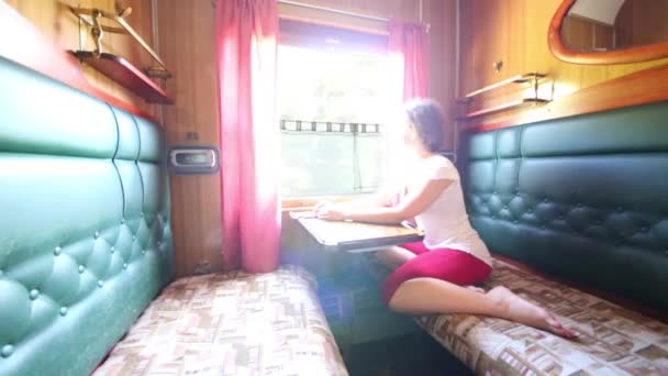 Woman in business-class compartment on train