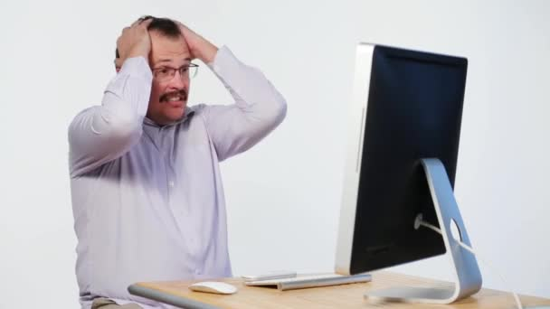 Employee in horror clutched his head while working on computer
