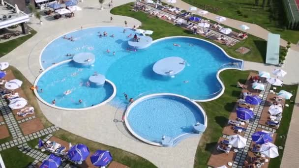 Large swimming pool with tourists