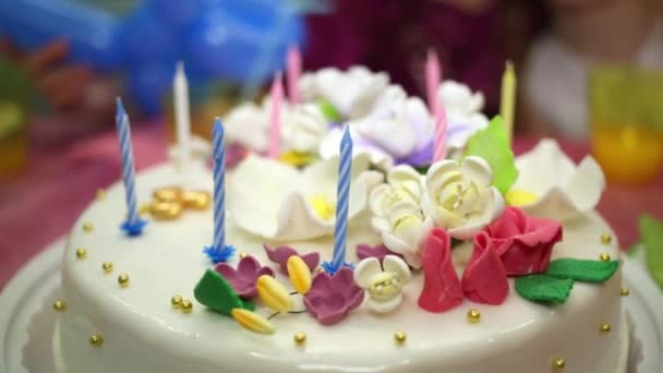 Child counts candles on birthday cake