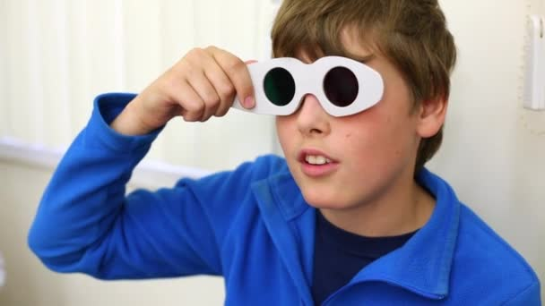 Boy checks eyesight