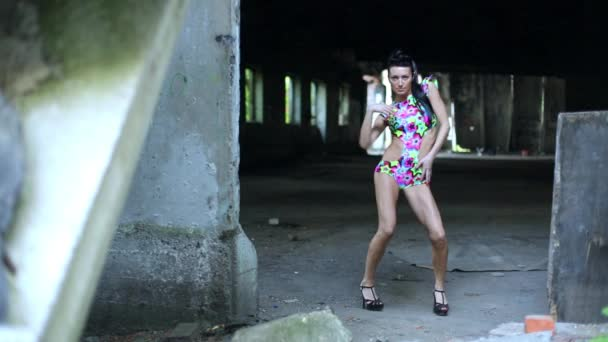 Girl dances on ruins of abandoned building