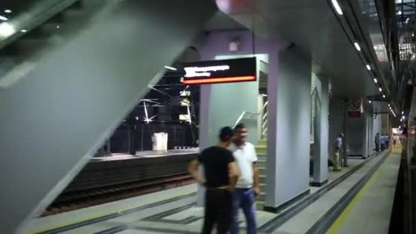People on platform waiting for arrival of train