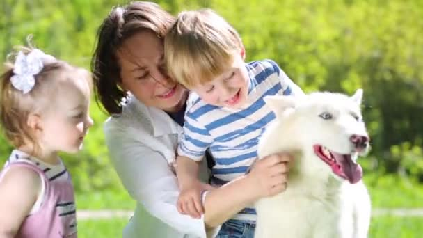 Mother with daughter and son with dog