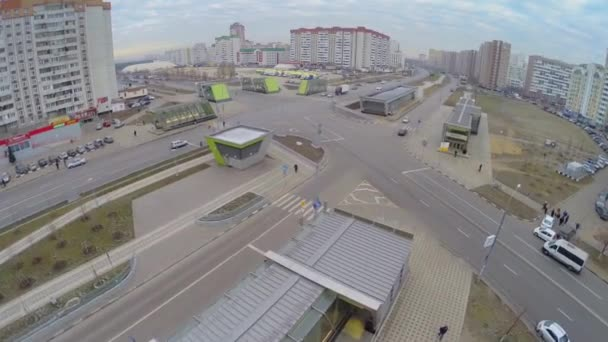 Cityscape with crossroad and entrance to metro station