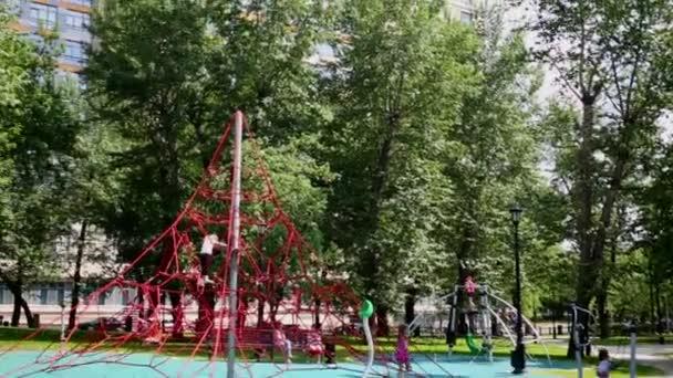 Children playground with pyramid net climber