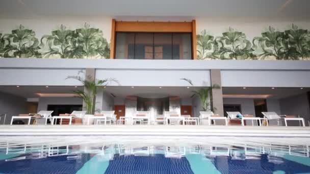 Hall with pool and white loungers