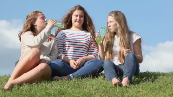 Three young girls drink