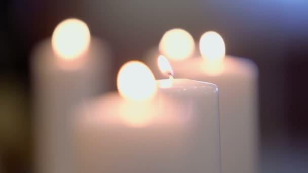 Several candles burn