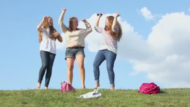 Three girls dance