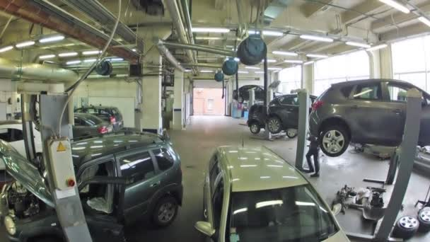 Cars stand in garage of service center