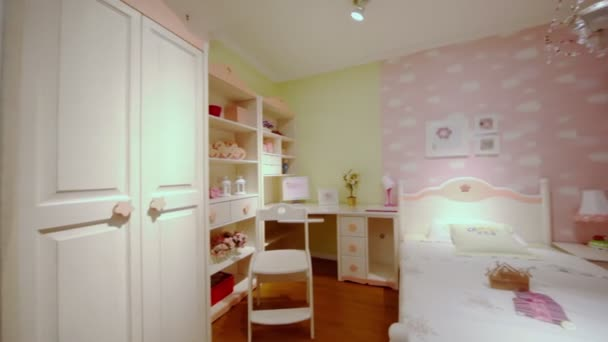Young girls bedroom with many furniture