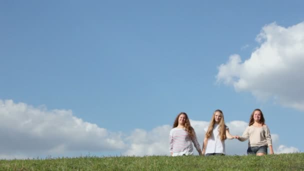 Three young girls walk
