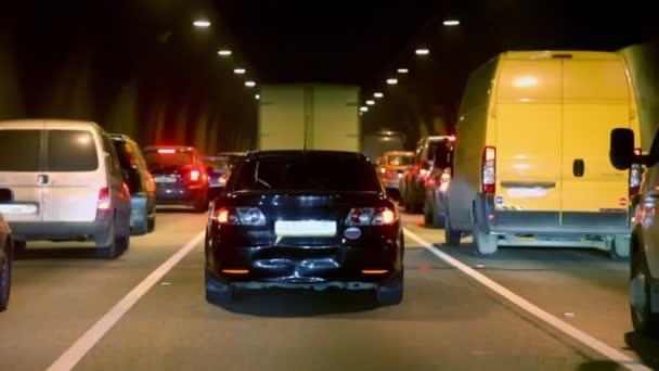 Cars make jam in dark tunnel