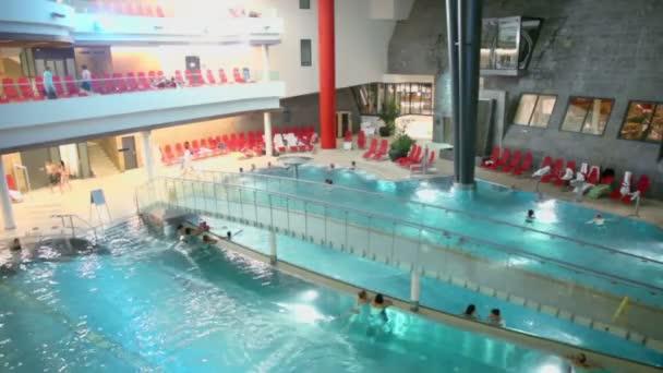 People swim in pool