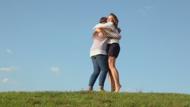 Two girls embrace