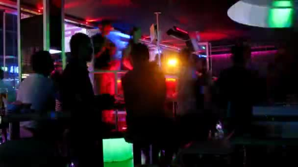 Young people dance in night club