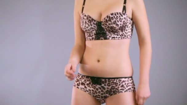 Young woman in underwear dances
