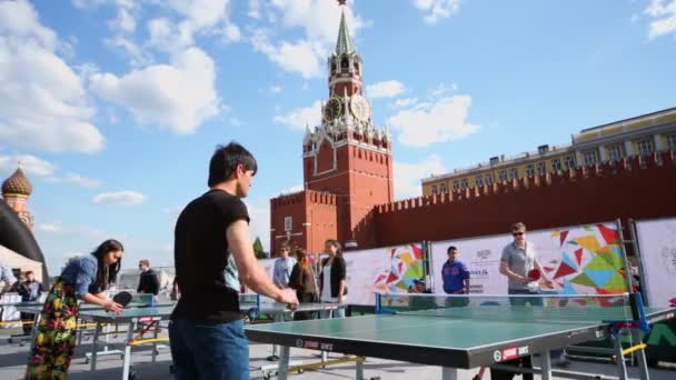 People play table tennis