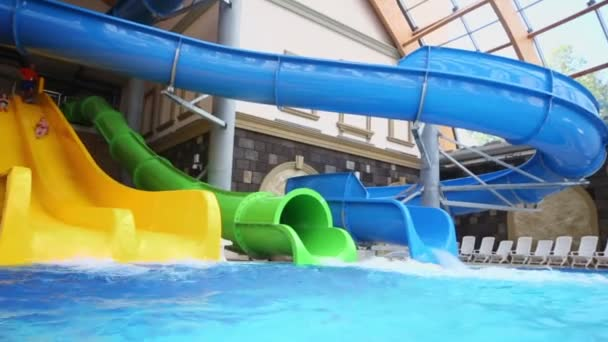 Two kids slid from water slides