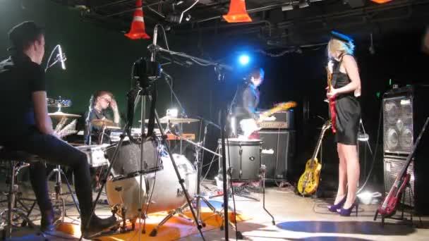 Band members rehearsing in studio