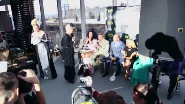 Journalists watch Lena Lenina speaks