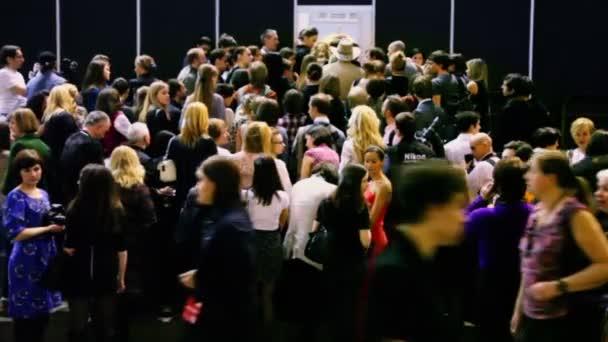 People wait at Volvo Fashion Week