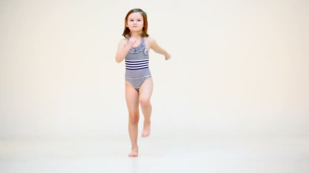 Little girl in swimsuit moving