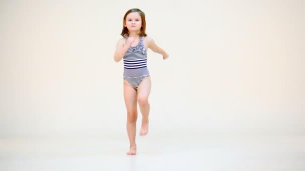 Little girl in swimsuit moving