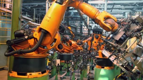 Roboty sváří autodíly